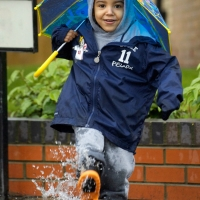d1315_105vcp-portrait-of-a-small-boy-splashing-in-a-puddlein-the-rain