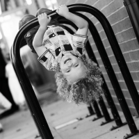 d1577_192-laughing-boy-hangs-upside-down-on-bike-rack