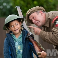 Agar Nook fun day: Harley Mead (8) gets a World War II ear-bashing from Brian Baker of the Tommy atkins Society, as he stands to attention. Photograph by Martin Neeves Photography - www.martinneeves.com - Tel: 01455 271849 / 07973 638591 - E-mail: mail@martinneeves.com