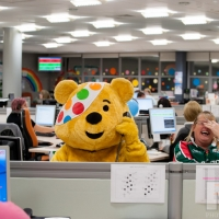 TNT staff raising cash for Children in Need: Pudsey Bear helps Julie Baldwin to answer the phones in the TNT's Lount Contact Centre. Photography by Martin Neeves Photography - www.martinneeves.com - Tel: +44 (0)7973 638591 - E-mail: mail@martinneeves.com