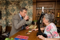 Resident Brenda McMahon pulls a pint for Emmerdale actor John Middleton at The Woolpack pub inside Kiwi House care home in Derby. Photograph by Martin Neeves Photography - www.martinneeves.com - Tel: +44 (0)7973 638591 - E-mail: martinneeves@googlemail.com