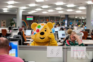 press releases TNT staff raising cash for Children in Need: Pudsey Bear helps Julie Baldwin to answer the phones in the TNT's Lount Contact Centre.